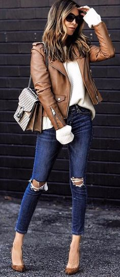 Cute overall look: The leather jacket is a nice shape and is feminine yet edgy enough to be interesting. The white sweater softens the look but doesn't clash. But the purse is hideous. I don't usualy like leather in this reddish-brown color. I dont think leather in this color is very versatile.