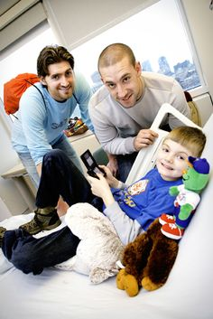 The Boston Red Sox Holiday Caravan brought pitcher Chris Carpenter, below left, outfielder Ryan Kalish, center, and team mascot Wally the Green Monster to MassGeneral Hospital for Children on Dec. 10.