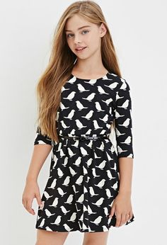 A 3/4-sleeved skater dress with an allover bird print, a removable faux patent leather belt, and a bow cutout accent in the back.- $14.90 (I don't know how the youngest one feels about dresses, let alone birds) The dress also comes in cream. Paired with black tights and flats would be super cute.