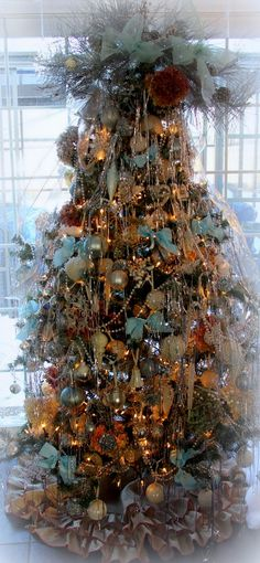 Copper, brown, gold and blue Christmas tree