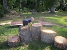 I'm working on designing a natural play area for the boys! Love the idea of different-height tree stumps! (Garden Step On A Slope)