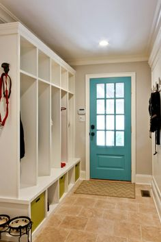 """With a splash of turquoise on your entry door, your mudroom will swim with color. Get a similar look with """"Surfer"""" by Behr."""