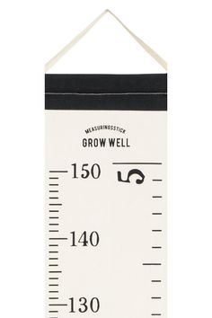 Wall hanger in cotton canvas with measurements in centimetres and inches and a fabric cord at the top for hanging. Screw not included. Size 21x161 cm. The p