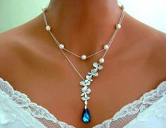 Wedding Necklace, Bridal Necklace, BERMUDA BLUE PEACOCK ORCHID Necklace, White Gold Orchid, White Pearl, double strand, blue necklace.  Six matte 16K white gold plated orchids are connected in a way t