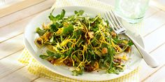 Arugula with Dates & Walnuts | Pepper arugula gets a smooth, creamy sensation with Sargento Shredded Reduced-Fat Sharp Cheddar Cheese. This salad is a healthful and satisfying sweet and savory combination.