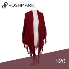 Burgundy knit shrug with fringe details. Burgundy knit shrug with fringe details. Can also be worn as a blanket scarf. 100% acrylic. One size fits most. Jackets & Coats