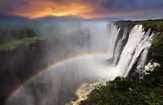 Victoria Falls sunset with rainbow, Zambia by Dietmar Temps