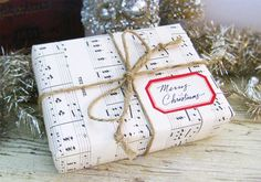 Store-bought wrapping paper is a social construct! Use something more fun, like sheet music: