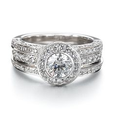 18ct white gold multiple band diamond ring.  Featuring a round brilliant centre diamond surrounded by pave brilliant cut diamonds.