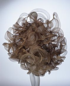 koji tatsuno, copper brown nylon dress in a spiral pattern. kyoto costume institute.