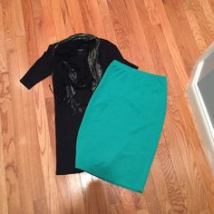 Green pencil skirt Never been wore. Pencil skirt would look great with a pair of boots or flats. Skirts Pencil