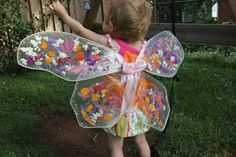 Make these childrens fairy wings with the wire frame from a torn set of wings (or just wire), contact paper, and flower petals. Great for a flower fairy!