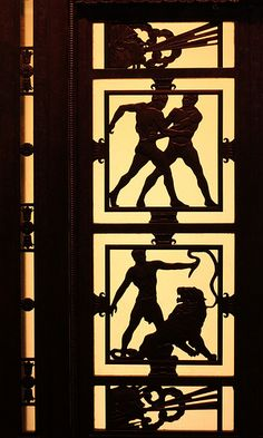 Zodiac Detail: Art Deco Lift Gates  This beautiful, bronze lift was installed in Selfridge's in 1928. Designed by Edgar Brandt. Showing Gemini and Leo.
