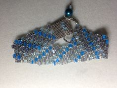 Blue & silver square beads pebble style. Credit goes to http://www.potomacbeads.com/