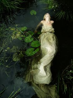 ~floating girl water dress lily pads photograph by an unknown artist (by Benjamin Whitley?) (drowned Ophelia is the subject matter? Fantasy Photography, Underwater Photography, Fashion Photography, Fairy Tale Photography, Photography Ideas, Water Shoot, Water Nymphs, Foto Fashion, Pre Raphaelite