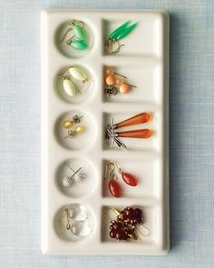 Ceramic watercolor palettes provide perfect slots for sorting & separating  jewelry w/no tangles. I searched local art stores, but I could not find the ceramic palette.  I purchased a ceramic palette @ fineartstore.com  Mine rests on the BR counter & I use it for organizing my daily supplements.