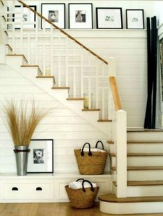 White staircase with contrasting paneling. The light wood is perfect for the farmhouse look