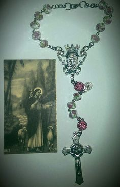 Flower car rosary with pink Our Father beads for orders email me at mimiandlola@gmail