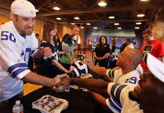 Dallas Cowboys players meet fans and sign autographs during Cowboys Fan Fest at Sunset Station May 6, 2012