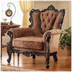 A grand armchair with dark wood finishes.