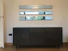 BOOK Sideboard with drawers. Sideboard with black glass frame with ceramic fronts. It has 2x door module and a set of drawers in the middle. Sideboard on legs or can be optioned to be on plinths. Delivered to our client in Surrey.