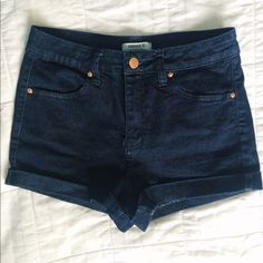 F21 denim shorts Dark blue denim shorts with a rose gold button. Rolled cuffs on each leg. Brand new condition. Slightly high waisted fit. Forever 21 Shorts Jean Shorts