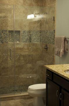 CMH Builders Custom tiled shower with frameless shower door
