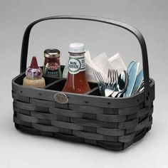 The Peterboro Condiment Caddy has wood compartments  to hold your condiments, plates, cooking utensils or cutlery. It keeps things organized while also making it easy to carry everything in one trip. The stationary handle is double riveted for added strength. This basket also works great for home office supplies, in a baby's room, and in a bathroom for toiletries.