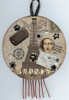 French Style Altered Cd with Mona Lisa & the Eiffel Tower.