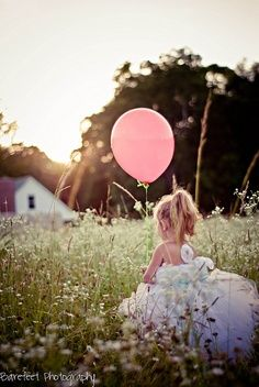 Little girl in field with balloon and pretty dress. {Family Photography Inspiration} {Beautiful Pose and Outdoor Setting} {Child Photoshoot Idea}