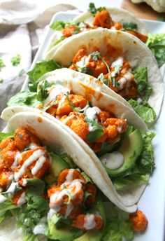 Buffalo Cauliflower Tacos - This Savory Vegan These Vegan Buffalo Cauliflower Tacos are packed full of spicy buffalo sauce, creamy ranch, crunchy romaine and hearty avocados Vegan Buffalo Cauliflower, Cauliflower Tacos, Cauliflower Recipes, Veggie Recipes, Mexican Food Recipes, Whole Food Recipes, Vegetarian Recipes, Cooking Recipes, Healthy Recipes