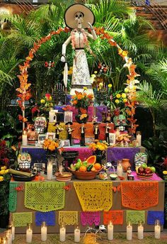 Altar de muertos or altar of dead, is what is presented in this picture. This is the favorite foods and colors and items of the deceased. This can be placed anywhere. Even in your house.