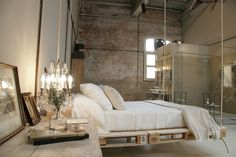 Bohemian / shabby chic bedroom. I adore the hanging bed made from repurposed crates and beautiful chandelier lamp.