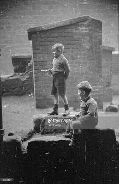 Two young boys playing with toy guns in a derelict area of the Gorbals in Glasgow The Gorbals...