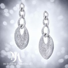 Holiday Magic in Diamonds. Morays signature diamond studded earrings lend the sophistication of simplicity to any look. Truly gorgeous, their 18 carat white gold, 12 carat diamond deep loops catch the light, the eye and the heart of any lady.