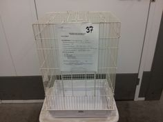 """Cage #37 - NOT AVAILABLE - table top cage. Dimensions: 17.5"""" x 13.5"""" x 24""""; B/S 3/4""""; Roof opens. White, clean. Jan 2016 - went to Nate Liebermann for his foster amazons, Freddie and Sammie."""