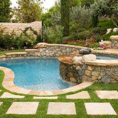 A beautifully crafted retaining wall that adds privacy to the pool area