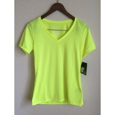 NWT Nike neon yellow dri-fit tee Brand new with tags Nike DRI-FIT tee in neon yellow. Size medium. Has a small yellow Nike logo on the left above bust (shown in last photo) Nike Tops Tees - Short Sleeve