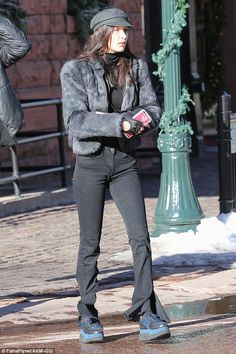A flare for fashion: Bella Hadid wore a fluffy jacket and flared jeans to go shopping in Aspen with her pals on Christmas Eve