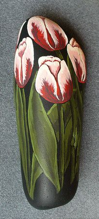 These tulips are painted on a smooth river rock from Utah that is about 9 inches in height.  The flowers and leaves are painted on the entire circumference of the rock.  This specimen is sitting in a flower pot in my living room.  This is my first effort at painting rocks.