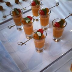 Tomato Gazpacho Shooters topped with a Mini Caprese Skewer.  By Blue Plate Catering in Chicago