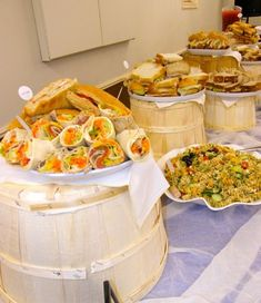 Wedding Food Catering on barrels. Interesting food display - Annapolis Valley Nova Scotia Wedding Catering- Serving weddings and events of all sizes. Custom catering menus, suited to your occasion,theme and budget. Catering Menu, Catering Display, Catering Ideas, Sandwich Catering, Sandwich Buffet, Catering Recipes, Catering Business, Wedding Reception Food, Wedding Catering