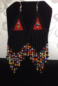 Handmade beaded long black and multicolored seed bead earrings. Stunning handmade beaded earrings made with black and super bright multicolored 11/0 seed beads. The earrings have long flowing multicolored fringe. The french hook earwires and findings are sterling silver. These gorgeous