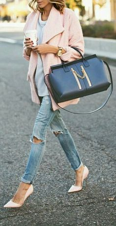 Jeans and pinky pink coat with heels make some fashionable street style.that skinny isn't pretty though