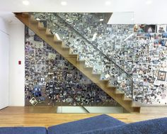 <<The architects at Slade Architecture in New York gave a family the ability to display a large number of photos in an asymmetrical display by lining a stair wall in metal, which allows the photos to be attached by magnets. The fact that they are all color images brings them together and makes a very personal work of abstract art.>>