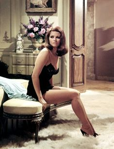 24femmespersecond:  Claudia Cardinale ready for bed in high heels and black negligée  Claudia Cardinale: Italian actress in european films and television.  View Post