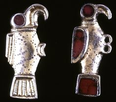Silver-gilt bird-brooch; cast profiled with moulded features; garnet inlaid tail, wing and eye; punched and incised linear decoration. - Merovingian, 6thC,