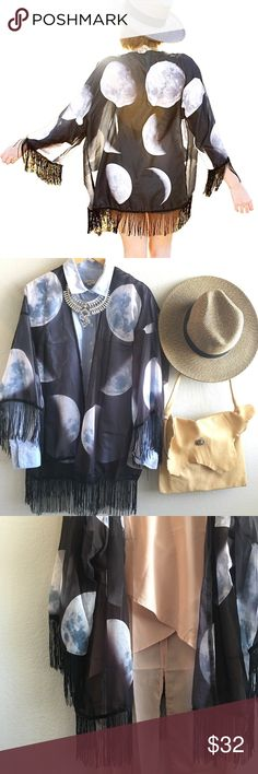 """To the Moon and Back Kimono Sheer lightweight Moon kimono. Different stages of moons cover this beauty. Fun and flirty black fringe along the bottom of sleeves and body.  Oversized fit     Length S:  4/6        27.25"""" M: 6/8        27.50"""" L: 8/10        28"""" XL: 10/12    28.5"""" Material: polyester & chiffon  Batwing sleeves                                                          • Price Firm • Owl About Happy  Other"""