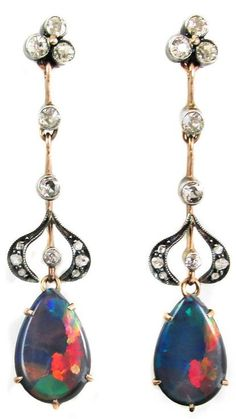 Edwardian Harlequin Black Opal Diamond Earrings. These unusual Edwardian earrings, handcrafted out of platinum topped rose gold, are set with 2 pear shape extremely rare black opals, displaying all colors from blue, green, orange to fiery red in a Harlequin pattern.