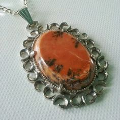 Estate Orange Picture Jasper Pendant Necklace Very unique Vintage  gemstone orange picture Jasper Pendant Necklace. Hung from a approximately 20 inch silver plated necklace. The intricate scroll is fascinating. Beautiful Vintage necklace. Purchased at the Palm Beach Antique and Jewelry show. Circa 1960s in very nice condition. Vintage  Jewelry Necklaces